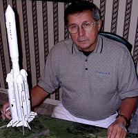Cosmonaut Viktor Savinykh Autographing our Angara Launch Vehicle Model.