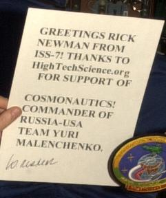 This is the sign which Commander Yuri Malenchenko is holding.