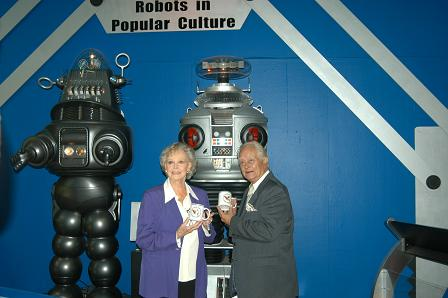 June Lockhart & Bob May in front of the HighTechScience.org robots