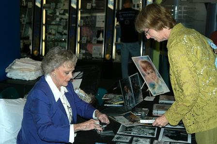 June Lockhart autographing a picture and talking with a fan at RoboFest.