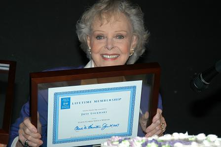 June Lockhart holds up her lifetime museum membership to the SFSM.