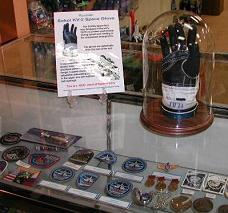 Here is part of our space artifact collection on display at the U.S. Space Walk of Fame Museum in Titusville, Florida.  Click on picture for more info.