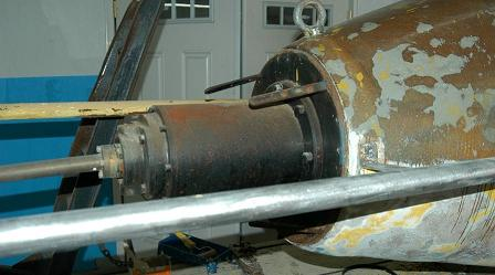Rear electric motor & propeller assembly being repaired.