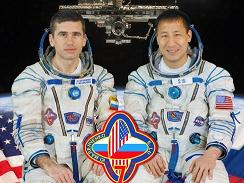 Expedition 7 Commander Yuri  Malenchenko and NASA ISS Science Officer & Flight Engineer Edward Lu.